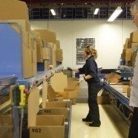 All the parts of an order are dispatched to one of many packaging areas and the operator fills boxes as directed.