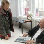 Erik Carlsson signing his book for my dad (Museum director Peter Bäckström can be seen in the background)
