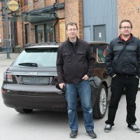 Jörgen Carlsson and his nephew Hampus in front of the Saab Car Museum. Photo: Saab Car Museum